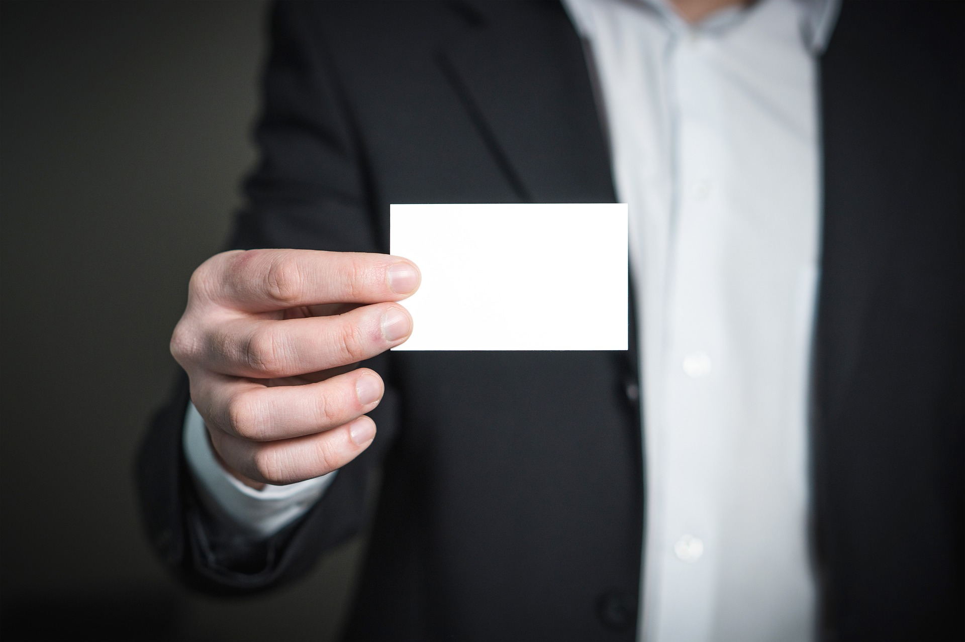 A value of business cards and banners for promoting your new man holding business card pixabay colourmoves