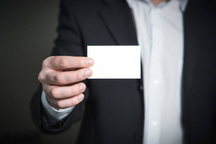 Man holding business card - www.pixabay.com