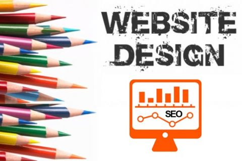 Website Design with pencils near monitor