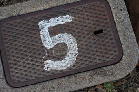 Number five painted on grate